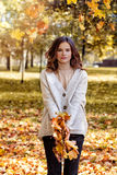 Woman Model with Fall Leaves in the Autumn Park Outdoors. Happy Woman Model with Fall Leaves in the Autumn Park Outdoors stock photos