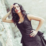 Woman, model of fashion, wearing black dress with curly hair Stock Image