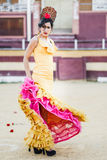 Woman, model of fashion, wearing a dress in a bullring Royalty Free Stock Photos