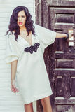 Woman, model of fashion, wearing white dress with curly hair Stock Photography