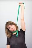 Woman model hanging choking measuring neck meter tape diet. Royalty Free Stock Images