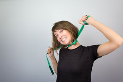 Woman model hanging choking measuring neck meter tape diet. Royalty Free Stock Image