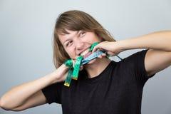 Woman model hanging choking measuring neck meter tape diet. Royalty Free Stock Photos