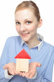 Woman with a model of a house Stock Photo