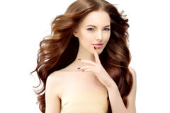Woman Model with long wavy hair. Waves Curls Hairstyle. Hair Sal Royalty Free Stock Image