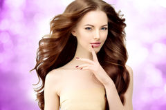 Woman Model with long wavy hair. Waves Curls Hairstyle. Hair Sal Stock Photo