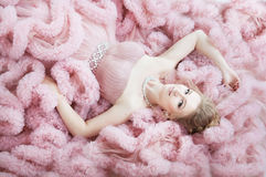 Woman, model lying on the floor in cloud dress. Fashion Royalty Free Stock Image