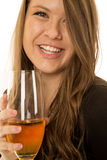 Woman model portrait close-up drinking some wine smiling. Brunette woman model portrait close-up of her drinking wine smiling Royalty Free Stock Photos