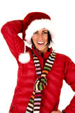 Woman model in santa hat and red coat Stock Image