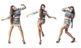 Woman model in short dress in full length in Studio on white bac Stock Photo