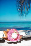 Woman model sunbathing on the beach chair Stock Photography