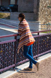 Woman Model on the walk. Closeup of shining model. Showing mexican pancho Royalty Free Stock Image
