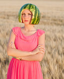 Woman model with water-melon on head Stock Image