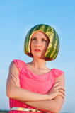 Woman model with water-melon on head Royalty Free Stock Photos