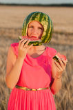 Woman model with water-melon on head Stock Images