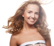 Woman model with windswept flying blond hair. Stock Photography
