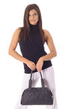 Woman modeling a bag Royalty Free Stock Photography