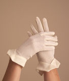 Woman modeling vintage formal mesh white gloves Royalty Free Stock Image