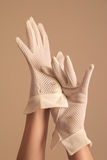 Woman modeling vintage formal white mesh gloves Royalty Free Stock Photography