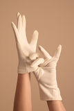 Woman modeling vintage knit white gloves Stock Image