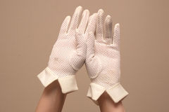 Woman modeling vintage mesh formal white gloves Stock Photo
