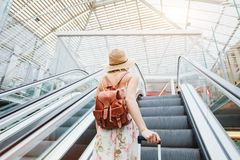 Woman in modern airport, people traveling with luggage. Abstract woman in modern airport, people traveling with luggage Royalty Free Stock Photography
