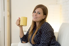Woman at modern apartment  living room home couch enjoying coffee tea cup Stock Photography