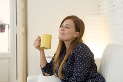 Woman at modern apartment  living room home couch enjoying coffee tea cup Stock Image