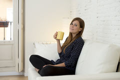 Woman at modern apartment  living room home couch enjoying coffee tea cup Royalty Free Stock Photos