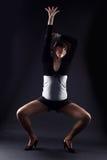 Woman modern dancer. Against black stock photos