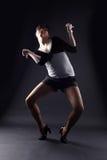 Woman modern dancer. Against black stock images