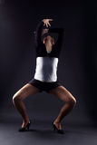 Woman modern dancer. Against black royalty free stock photography