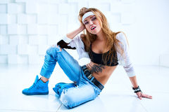 Woman modern dancer. Young woman modern dancer with tattoo on body in bright white interior stock images