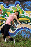 Woman modern dancers. In city against graffiti wall Stock Images