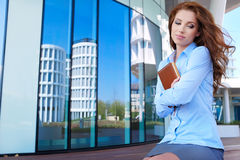 Woman in modern glass interior Royalty Free Stock Images