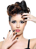 Woman with modern hairstyle and black nails. Beautiful glamour woman with modern hairstyle and black nails. Fashion eye make-up. Isolated on white royalty free stock photos