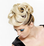 Woman with modern hairstyle and blue make-up Royalty Free Stock Image