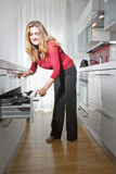 Woman in modern kitchen Royalty Free Stock Photo
