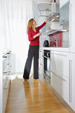 Woman in modern kitchen Royalty Free Stock Photography