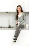 Woman in modern kitchen Royalty Free Stock Images