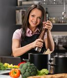Woman on a modern kitchen Royalty Free Stock Photo