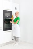 Woman modern kitchen appliance setting Stock Photography