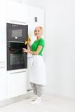 Woman modern kitchen appliance setting Stock Photography