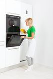 Woman modern kitchen appliance setting Royalty Free Stock Photos