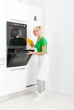 Woman modern kitchen appliance setting Royalty Free Stock Image