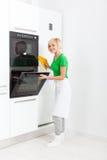Woman modern kitchen appliance setting Royalty Free Stock Image