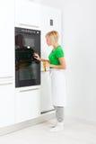 Woman modern kitchen appliance setting Stock Images