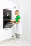 Woman modern kitchen appliance setting Royalty Free Stock Photography