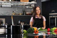 Woman on modern kitchen Royalty Free Stock Images