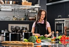 Woman on modern kitchen Stock Photography